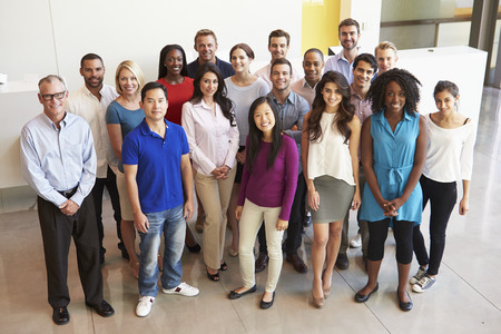 mixed race people: Portrait Of Multi-Cultural Office Staff Standing In Lobby Stock Photo