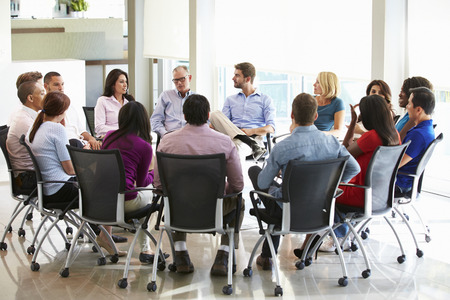 round chairs: Multi-Cultural Office Staff Sitting Having Meeting Together Stock Photo