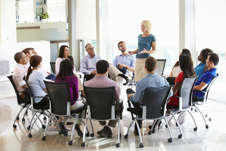 woman boss: Businesswoman Addressing Multi-Cultural Office Staff Meeting