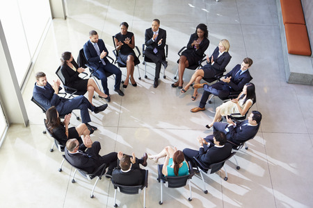 lady boss: Multi-Cultural Office Staff Applauding During Meeting