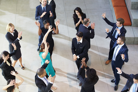 elevated view: Overhead View Of Businesspeople Dancing In Office Lobby