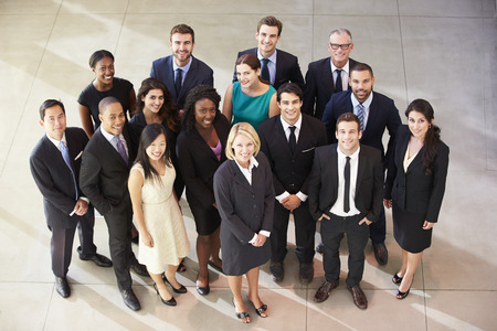 woman business suit: Portrait Of Multi-Cultural Office Staff Standing In Lobby Stock Photo