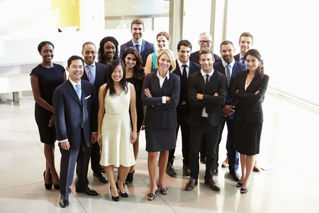 business women: Portrait Of Multi-Cultural Office Staff Standing In Lobby Stock Photo