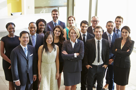 people together: Portrait Of Multi-Cultural Office Staff Standing In Lobby Stock Photo