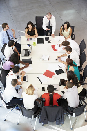 verticales: Empresario Abordar Reunión Alrededor de juntas Tabla