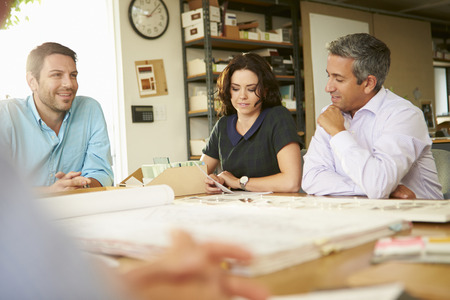 interior designers: Four Architects Sitting Around Table Having Meeting