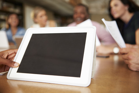 Digital Tablet Being Used By Architect In Meeting photo