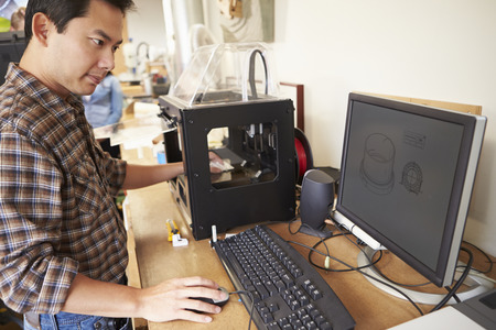 Male Architect Using 3D Printer In Office