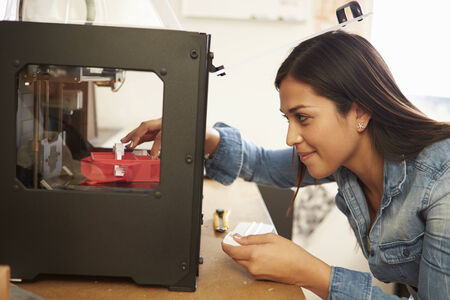 Female Architect Using 3D Printer In Office Stock Photo