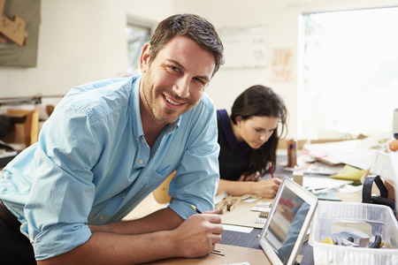 female architect: Two Architects Making Models In Office Using Digital Tablet Stock Photo