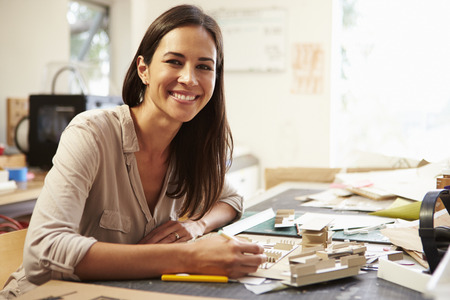asian architect: Female Architect Making Model In Office