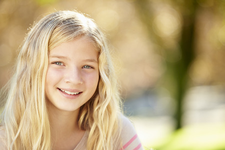 10 years old: Portrait Of Pretty Girl In Countryside