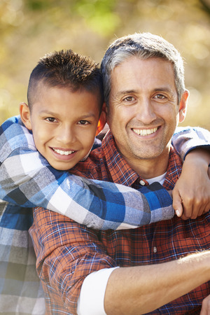active lifestyle: Portrait Of Father And Son In Countryside