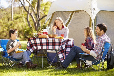 10 years old: Family Enjoying Camping Holiday In Countryside Stock Photo