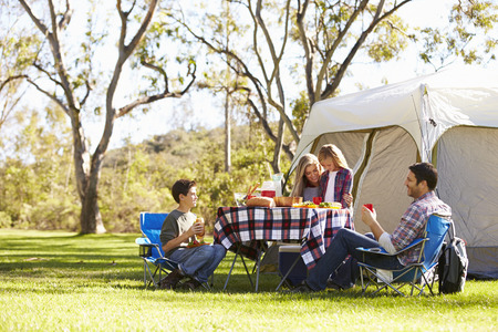 8 10 years: Family Enjoying Camping Holiday In Countryside Stock Photo