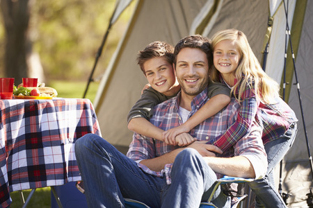 8 10 years: Father And Children Enjoying Camping Holiday In Countryside