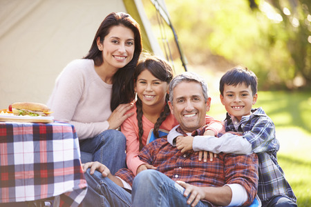 Family Enjoying Camping Holiday In Countryside Stock Photo - 31050639