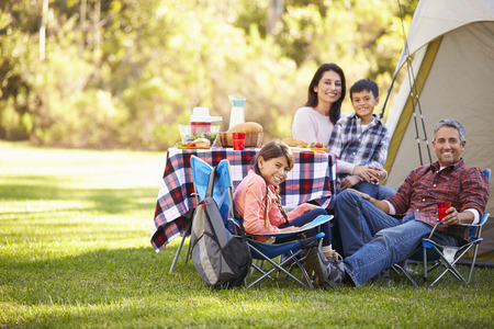 Family Enjoying Camping Holiday In Countryside 스톡 콘텐츠