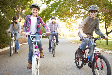 8 10 years: Family On Cycle Ride In Countryside Stock Photo