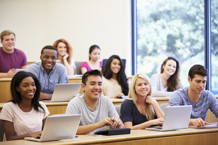college student: Students Using Laptops And Digital Tablets In Lecture