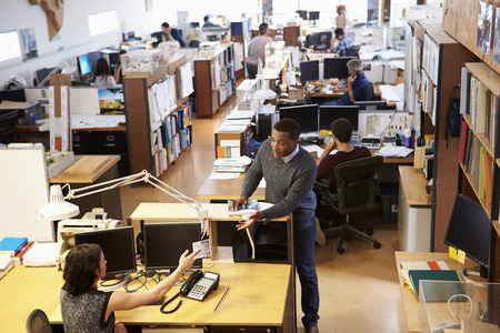 Interior Of Busy Architect's Office With Staff Working Standard-Bild