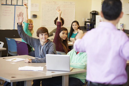 high class: High School Students With Teacher In Class Using Laptops