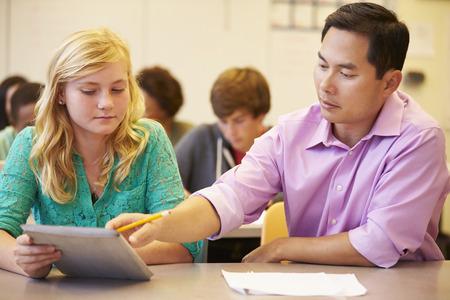 High School Student With Teacher Using Digital Tablet photo