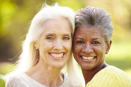 Portrait Of Two Mature Female Friends Hugging photo