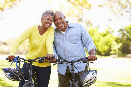 active: Senior Couple On Cycle Ride In Countryside