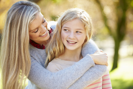 smiling people: Mother And Daughter In Countryside Stock Photo