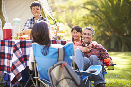 Family Enjoying Camping Holiday In Countryside photo