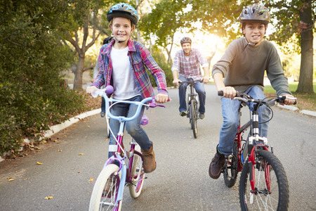 10 years old: Family On Cycle Ride In Countryside Stock Photo