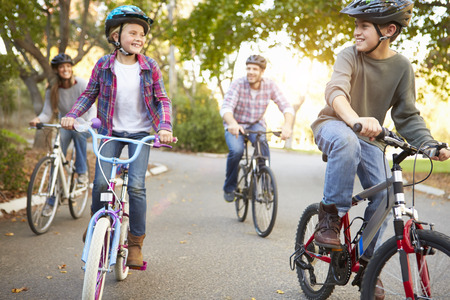 family exercise: Family On Cycle Ride In Countryside Stock Photo