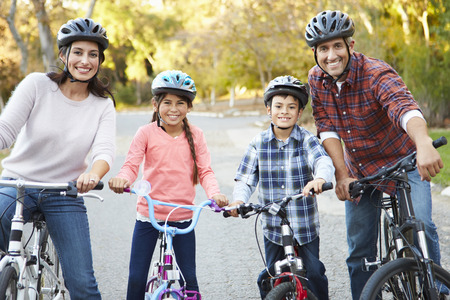Portrait Of Hispanic Family On Cycle Ride In Countryside photo