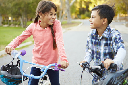 8 9 years: Two Children On Cycle Ride In Countryside Stock Photo