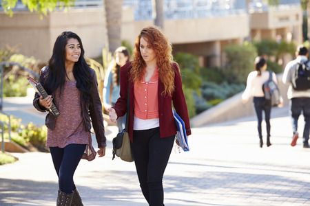college campus: Female Students Walking Outdoors On University Campus