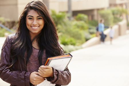 college campus: Portrait Of Female University Student Outdoors On Campus