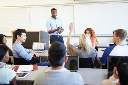 teach: Male Tutor Teaching University Students In Classroom