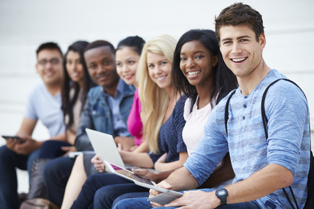 student: Portrait Of University Students Outdoors On Campus Stock Photo