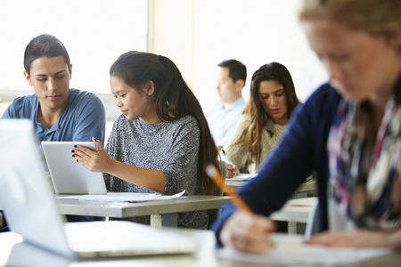High School Students With Laptops And Digital Tablets Standard-Bild