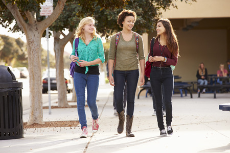 Three Female Students Walking To High School photo