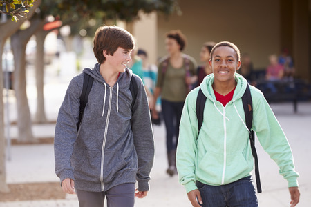 Two Male Students Walking To High School photo