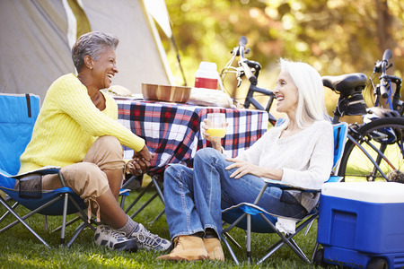 中年の女性: Two Mature Women Relaxing On Camping Holiday 写真素材