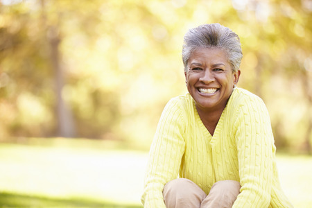 people smile: Mature Woman Relaxing In Autumn Landscape Stock Photo