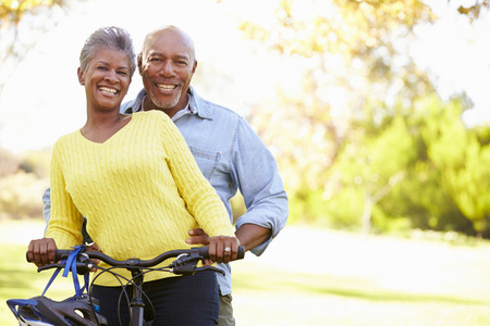 african american couple: Senior Couple On Cycle Ride In Countryside