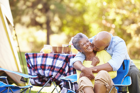 Senior Couple Enjoying Camping Holiday In Countryside Stok Fotoğraf
