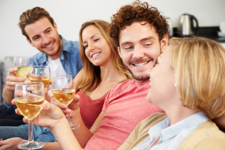 man glasses: Group Of Friends Enjoying Glass Of Wine At Home