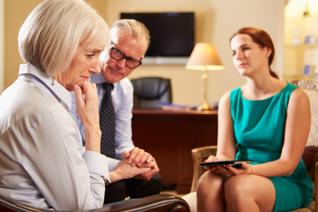 counsellor: Older Couple Talking To Counsellor Using Digital Tablet