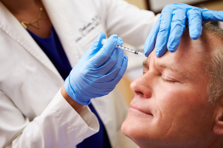 beauty treatment clinic: Man Having Botox Treatment At Beauty Clinic