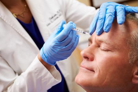 to inject: Man Having Botox Treatment At Beauty Clinic